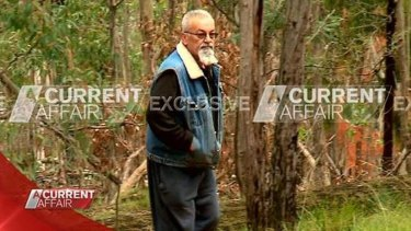 Video still shows Vasko Ristevski emerging from the scrub during filming of Nine's A Current Affair.