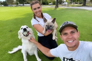 Matt Toomua and girlfriend Naomi with their dogs.