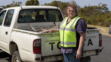WIRES volunteer Janine Green collecting the dead kangaroos.