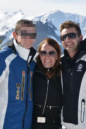 On a skiing  trip with her  son and her  second husband, Anthony Koletti.