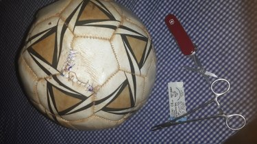 Red Cross worker Salah Raya sutured a soccer ball so young villagers, devastated by an oil tanker explosion, could continue their game.