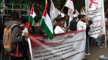 A small group outside the Australian embassy in Jakarta on November 30  holding Palestinian flags and protesting against Australia's consideration of  moving its embassy from Tel Aviv to Jerusalem.