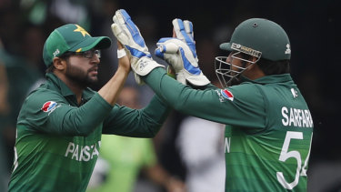 Pakistan's Imam-ul-Haq celebrates with captain Sarfaraz Ahmed after taking a catch to dismiss South Africa's Quinton de Kock at Lord's on Sunday.