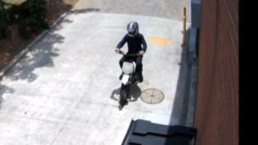 CCTV footage showed a man in a helmet riding a bike around the hairdresser.