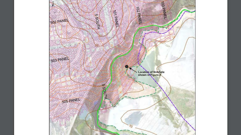 Site map showing the old Awaba coal mine workings (red hatching), the limit of the existing ash dam (broken green line), and the proposed extension of the dam (solid green line). A sinkhole is shown as a black dot.