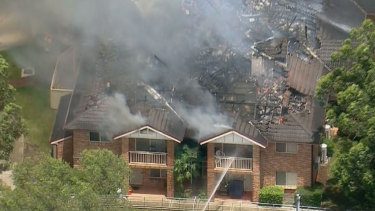An apartment complex in Bass Hill has caught fire and the roof has collapsed.