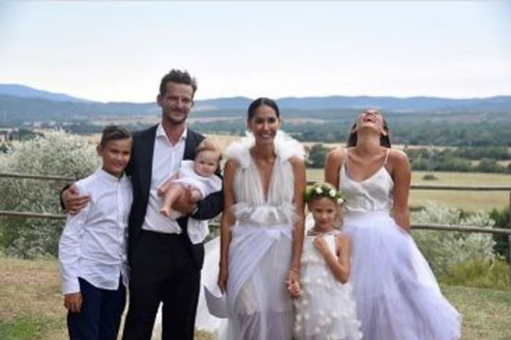 Lindy Klim marries Adam Ellis in Italy surrounded by her three children from her first marriage to Michael Klim and the newlywed's daughter, Goldie.