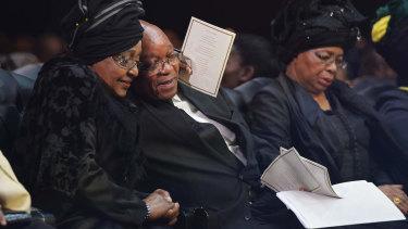 Winnie Madikizela-Mandela hugs South African President Jacob Zuma following his speech during the funeral service for Nelson Mandela.