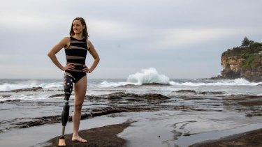 Paralympic swimmer Ellie Cole posing for Cate Campbell on the coast at Dee Why in Sydney.