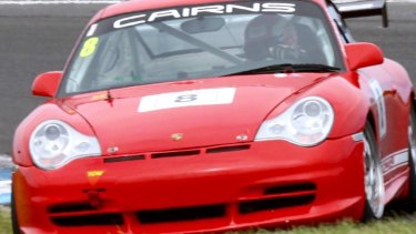 Justice Lasry at the wheel of his racing Porsche 996.
