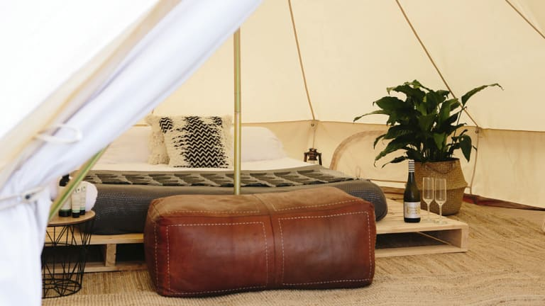 A Twilight Glamping setup can include everything from comfy beds to snack boards and indoor plants.