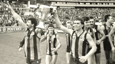Hawthorn do a lap of honour with the cup after beating Melbourne in the 1988 grand final.