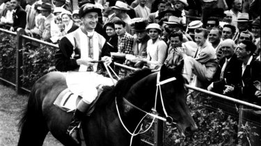 Champion: Tulloch returns to scale with  George Moore after winning the 1957 Victoria Derby at Flemington.