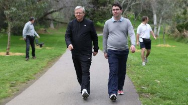 Prime Minister Kevin Rudd walks with advisor Patrick Gorman during an early morning walk in Adelaide.