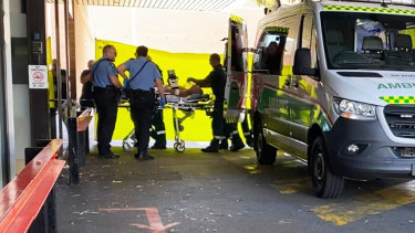The man attacked by a shark in the Swan River on Thursday morning arrives at hospital.