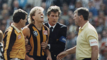 Geelong v Hawthorn.  MCG.  Dermott Brereton receives attention from medical staff after being flattened by Mark Yeates in the opening moments of the first quarter, Grand Final 1989