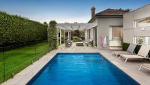 The home features a solar-heated pool.