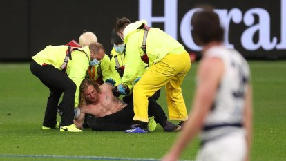 Optus Stadium hits topless pitch invader with three-year ban