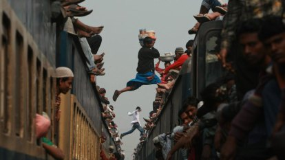 Train derails over canal in Bangladesh