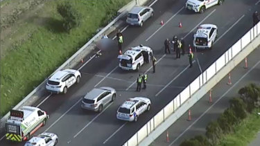 Police at the scene of the suspected shooting on the Monash Freeway