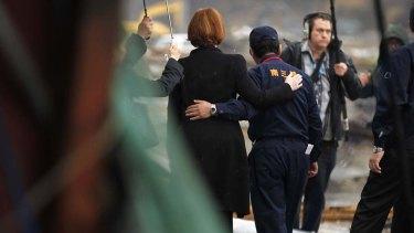 Then prime minister Julia Gillard and mayor Jin Sato in Minamisanriku in 2011.