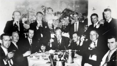 The Special Duties Gaming Branch celebrate an early raid. Mick Miller is seated third from the left. Fred is opposite him.