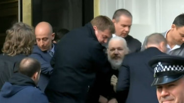 Julian Assange as he was arrested by British police.