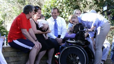 Opposition Leader Tony Abbott meets with families during his visit to Bear Cottage in Manly.