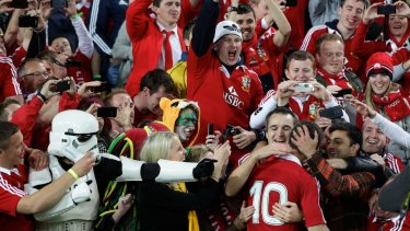 Jonathan Sexton celebrating with the Lions fans after winning the third Test against the Wallabies in 2013.