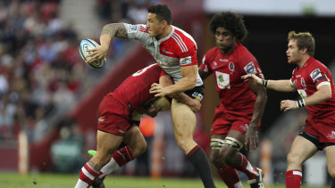 Sonny Bill Williams is tackled by Reds player Anthony Faingaa in the 2011 decider.