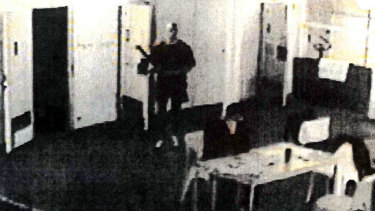 Prison CCTV captures the moment prisoner Matt Johnson ambushes Carl Williams, who was reading a newspaper before he was fatally bashed. It wasn't <i>The Age</i>.