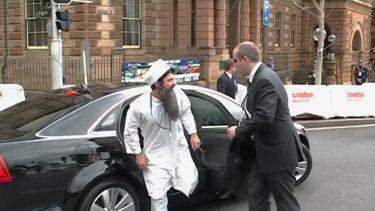 Chas Licciardello dressed as Osama bin Laden