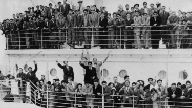 Immigrants from Europe arrive at Station Pier in the 1940s. State and federal governments are being urged to revisit post-war migration policy to secure the economy.