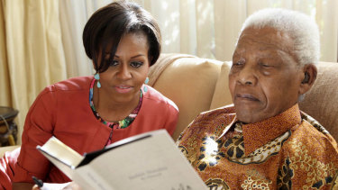 Michelle Obama meets former  South African president, Nelson Mandela, 92, at his home in Houghton in 2011. President Obama was unable to attend due to commitments in Washington.