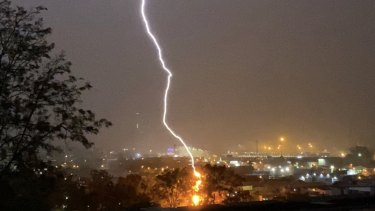 Lightning strikes in Brisbane as storms hit south-east Queensland (file image).