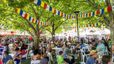 People rest in the shade at the Multicultural Festival.