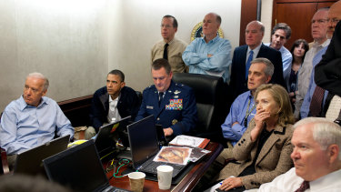 US President Barack Obama and senior White House aides and officials watch the operation that ended in the killing of Osama Bin Laden in Abbottabad, Pakistan. James Clapper can be seen standing on the far right.