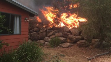 Bushfire close to homes at Upper Yango Creek, Laguna, in the Hunter region, on Thursday.