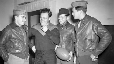 War stories: Three US airmen interested in Australian Rules football are photographed with Squadron Leader and Melbourne Football Club  champion Keith Truscott in 1942.