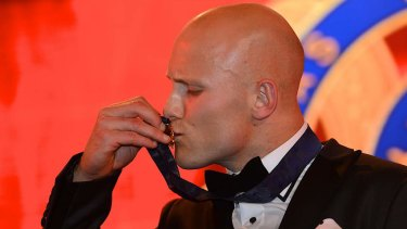 Gary Ablett kisses the 2013 Brownlow Medal.