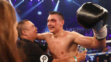 Tim Tszyu celebrates with his grandfather Boris after defeating Dennis Hogan in Newcastle.