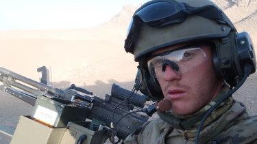 Robert Poate commanding a bushmaster in Afhanistan.