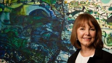 Darleen Bungey with artist John Olsen's work.