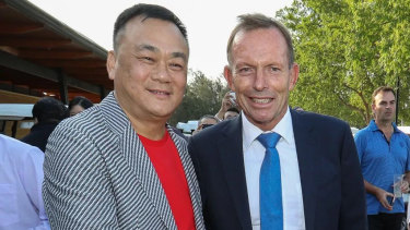 Jack Lam and Tony Abbott the Twin Creeks Golf and Country Club in 2018.