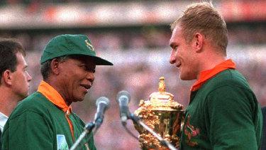 South African president Nelson Mandela hands over the Webb Ellis Cup to Springboks captain Francois Pienaar in 1995.