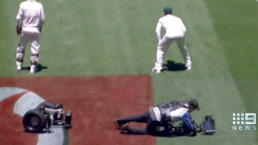 Nine life: Cameraman Joe Previtera, seen here in a tumble during a Test match, is now with Channel Seven.