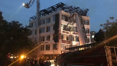 Rescued hotel guest Sivanand Chand photographed firefighters rescuing people during the early morning fire at the Arpit Palace Hotel in Delhi.