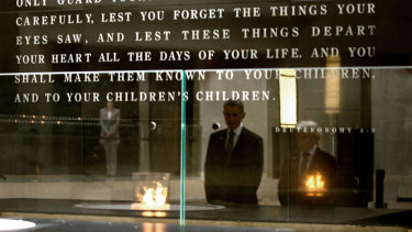Former US president Barack Obama with Elie Wiesel, Holocaust survivor and founding chairman of the United States Holocaust Memorial Council at the Hall of Remembrance at  the Holocaust Memorial Museum in Washington, DC.