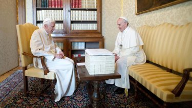 Pope Benedict XVI speaks to Pope Francis during a meeting in Castel Gandolfo.