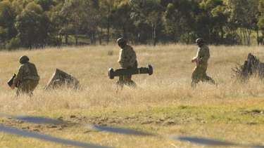 Cavalry dismounts prepare to fire a Javelin Anti-Tank Missile at a target.